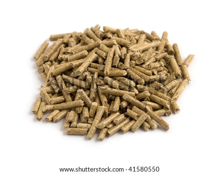 Small heap of wood pellets on white background focus on the middle of the heap - stock photo