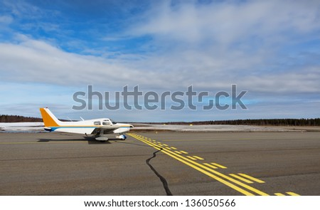 Small hobby aircraft parked at private airport - stock photo