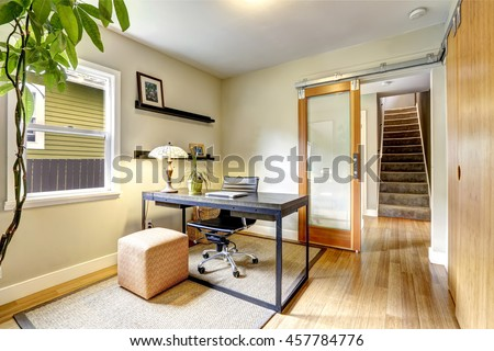 Small home office interior with hardwood floor. View of staircase. Northwest, USA