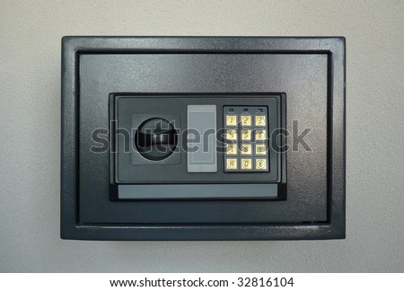 Small home or hotel wall safe with keypad, closed door - stock photo