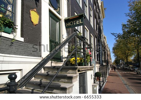 Small hotel on an Amsterdam canal - stock photo