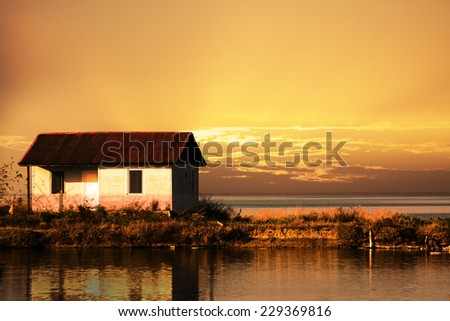 Small House and beautiful sunset - stock photo