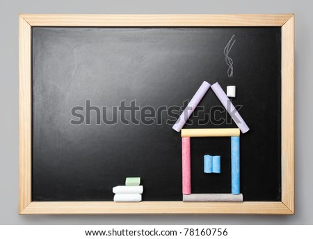 Small House from a chalk on a black chalkboard