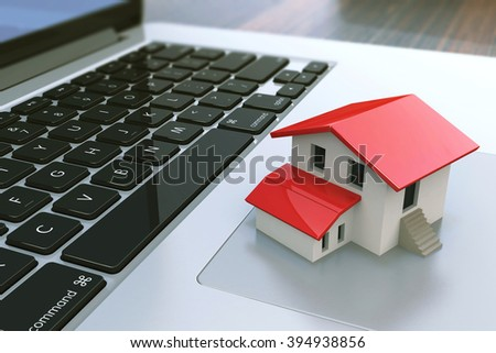 Small house on laptop keyboard. Real estate agency online. Concept. 3d illustration - stock photo