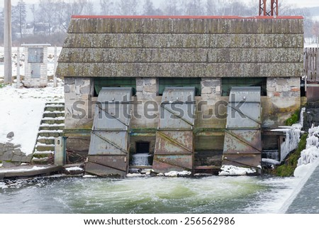 Small hydroelectric power station is situated near the river,Czech Republic - stock photo