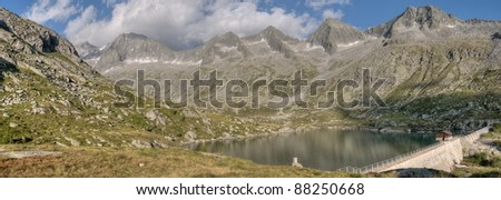 Small hydroelectric reservoir in Val Miller, Adamello group, northern Italy - stock photo