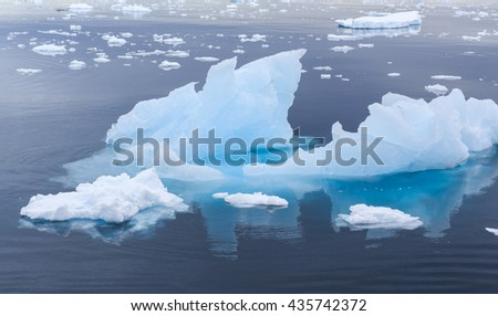 Small icebergs near Antarctica - stock photo