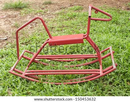 Small iron horse on grass - stock photo