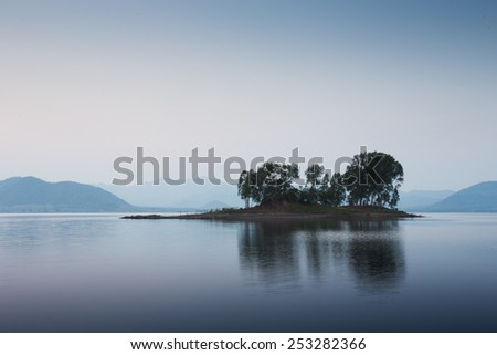 Small island in blue environment. It is feeling cool and peaceful. - stock photo