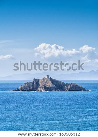 Small Island in front of Punta Ala Tuscany Italy with Elba Island in the background