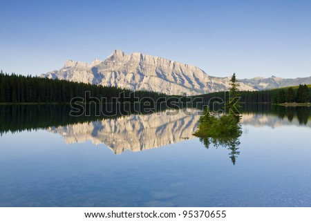 Small island in the middle of Two Jack Lake, Banff National Park (Alberta, Canada) - stock photo