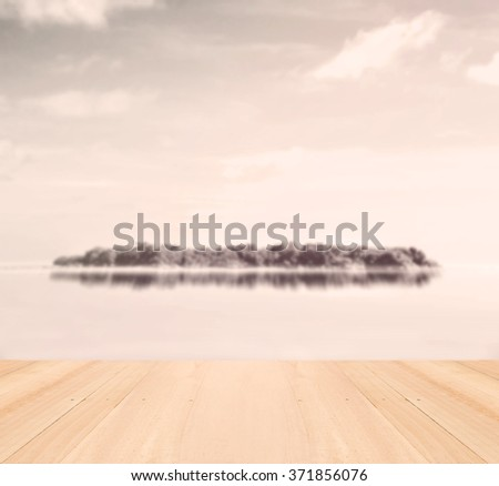 Small island in tropical sea with wooden floor. - stock photo