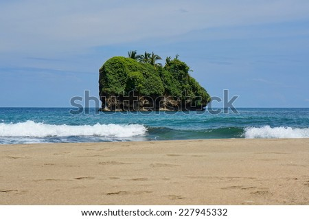 Small island off the beach of Cocles on the Caribbean side of Costa Rica, Puerto Viejo de Talamanca - stock photo