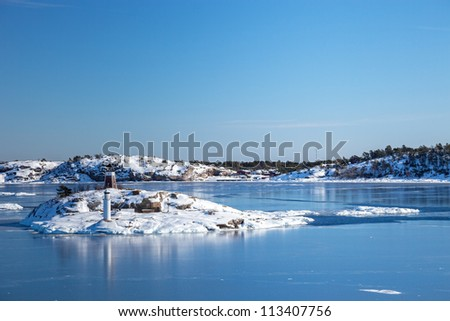 Small islands in the sea in winter scenery. Nynashamn, Sweden.