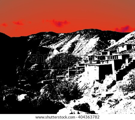 Small, isolated village clings to the steep sides of the High Atlas mountains in Morocco