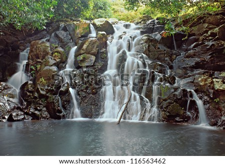 Small jungle waterfall with pool in Africa - stock photo