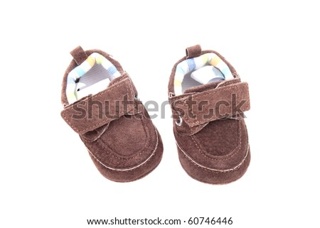 Small kid shoes isolated over white background