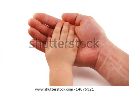 Small kids hand in man's hand