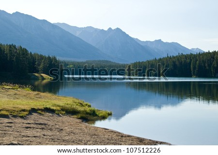 Small lake in Canadian Rockies, sunrise - stock photo