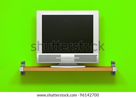 Small LCD TV, green wall