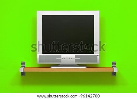 Small LCD TV, green wall - stock photo