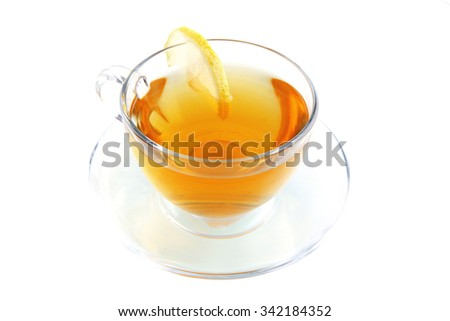 small light tea transparent glass cup with lemon cut isolated on white background - stock photo
