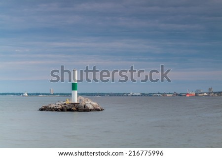 Small lighthouse and sailboat in Milwaukee, Wisconsin - stock photo