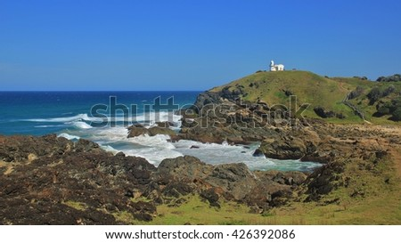 Small lighthouse on top of a hill. Pacific coast in Port Macquarie, Australia. - stock photo