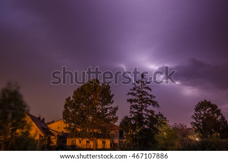 small lightning in the night in a village