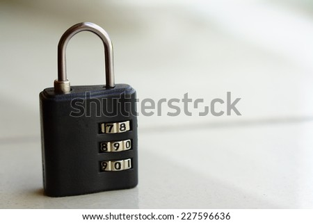 Small lock with numbers combination - stock photo