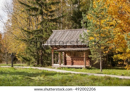 small log chapel in autumn forest