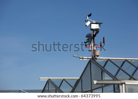 Small meteo station in an industrial farm - stock photo