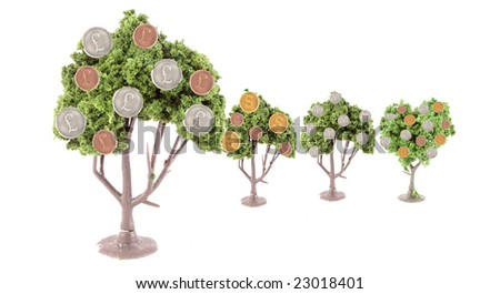 small miniature forest growing copper and silver dollars, yen, euros and  pound coins ... British pound tree is in front showing strength in currency exchange