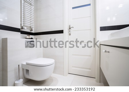 Small, modern bathroom in balck and white - stock photo
