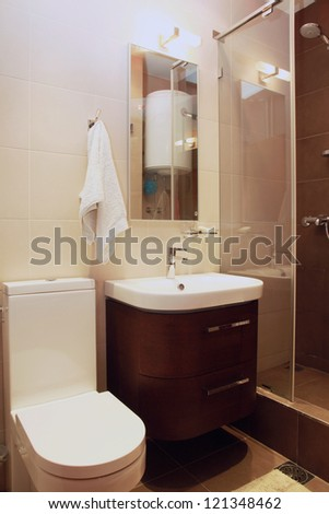 Small modern bathroom interior with brown tiles