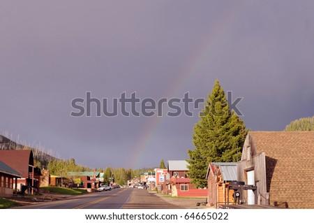 Small Montana town sports rainbow after rain - stock photo