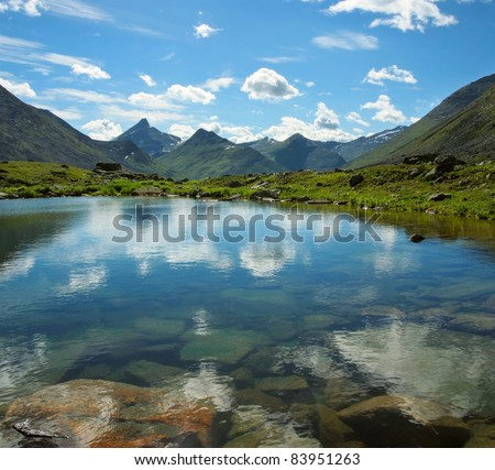 Small mountain lake in Ural mountains, Yugyd Va National Park, Near-Polar Ural, Russia. - stock photo