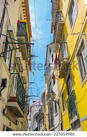 Small narrow street in Lisbon - stock photo