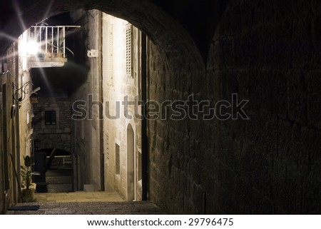 Small narrow street in old medieval town Korcula  by night. Croatia, Europe. - stock photo