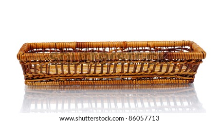 Small new wicker basket on a white background