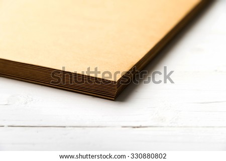 small of brown stack paper on white table