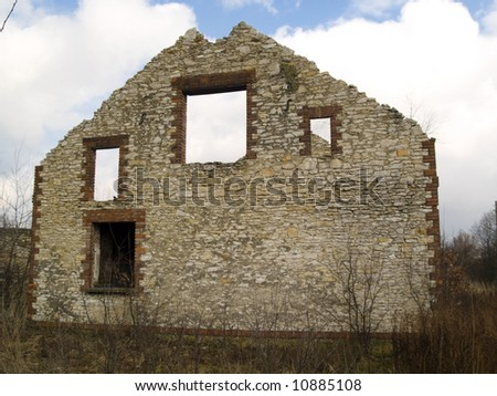 Small old brick building on the field. Blue sky. Winter time - stock photo