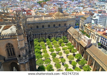 Small orange trees in the patio of the Cathedral of Saint Mary of the See (Seville Cathedral) in Seville, Andalusia, Spain - stock photo