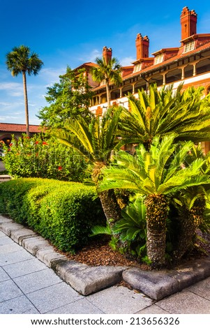 Small palm trees and building at Flagler College, in St. Augustine, Florida. - stock photo