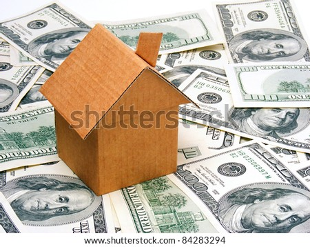 Small paper house on a dollars