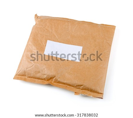 small paper post parcel with blank label isolated on white - stock photo