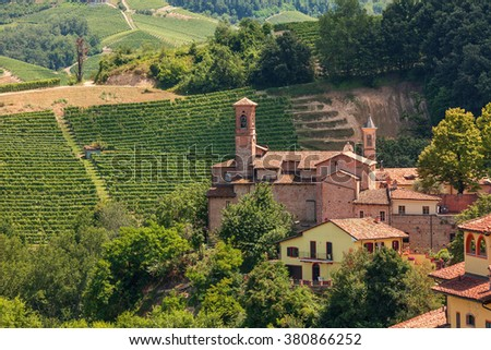 Small parish church among green vineyards in Piedmont, Northern Italy.