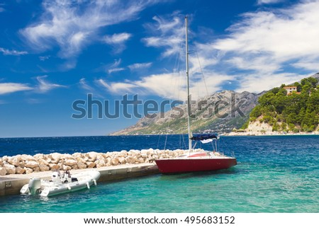 Small pier and yacht in Stomarica, Brela in Croatia