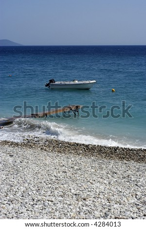 small pier at the sea with boat