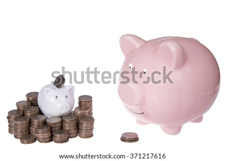 Small piggy bank with piles of quarters, large piggy bank with small pile of coins. Cost of raising children, college education, younger generation having better job income due to tech savy know how